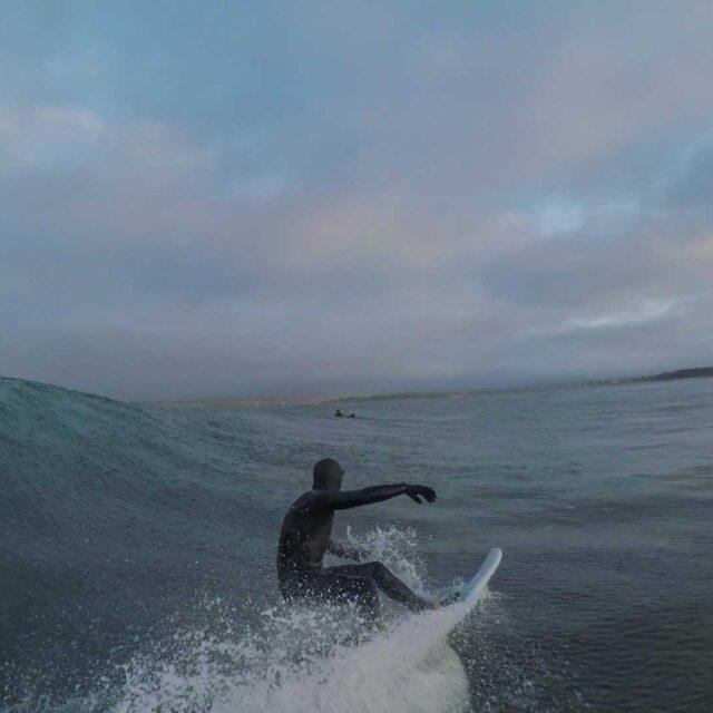 Luke Underwood surfing
